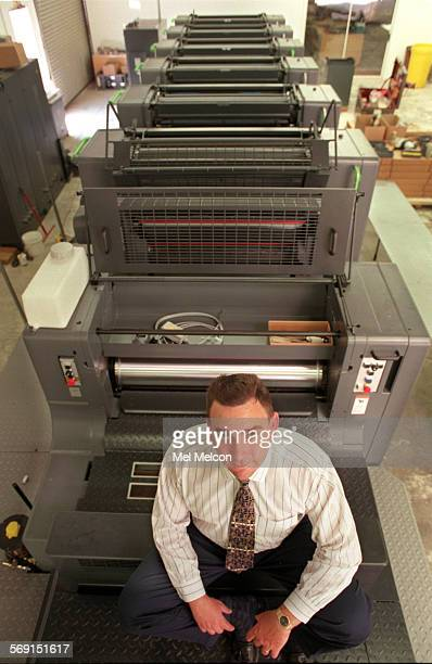 Mark Holden President of Holden Color Inc in Newbury Park poses by 3 million dollar Heidelberg Speedmaster CD102–6LX printing press located inside...