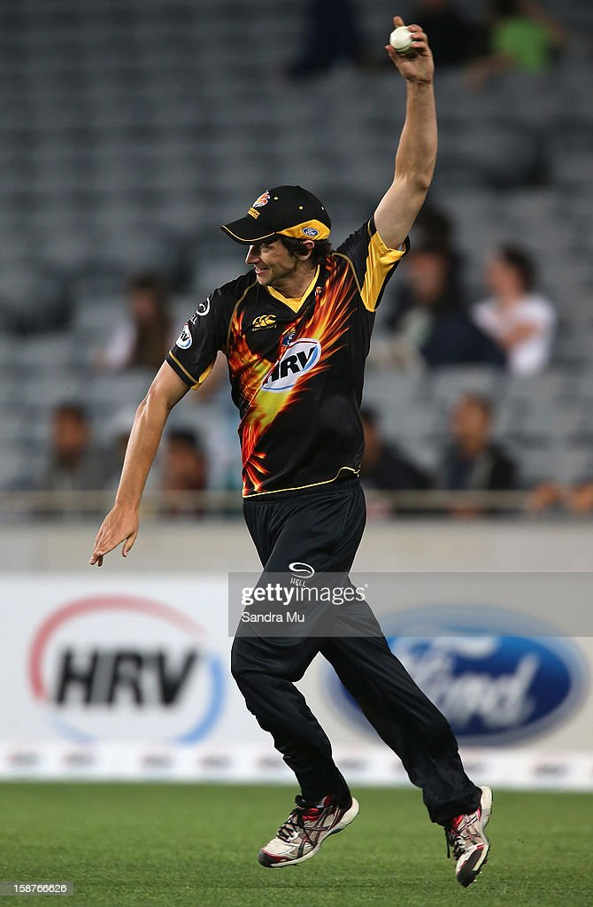 Mark Houghton of Wellington celebrates the catch of Bradley Cachopa of Auckland during the HRV Cup Twenty20 match between the Auckland Aces and Wellington Firebirds at Eden Park on December 28, 2012 in Auckland, New Zealand.