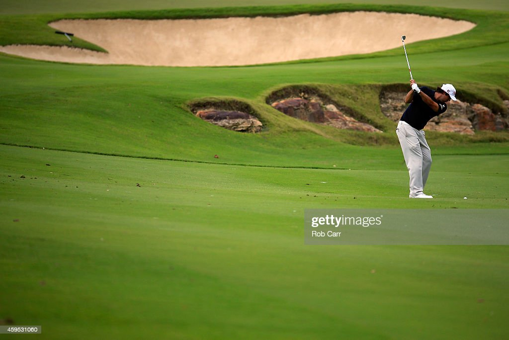 Mark Hubbard of the United States hits a shot during the third round of the OHL Classic at Mayakoba on November 15, 2014 in Playa del Carmen, Mexico.