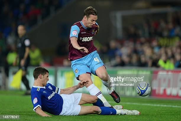Mark Hudson of Cardiff City battles with Kevin Nolan of West Ham United during the Npower Championship Playoff SemiFinal 1st leg match between...