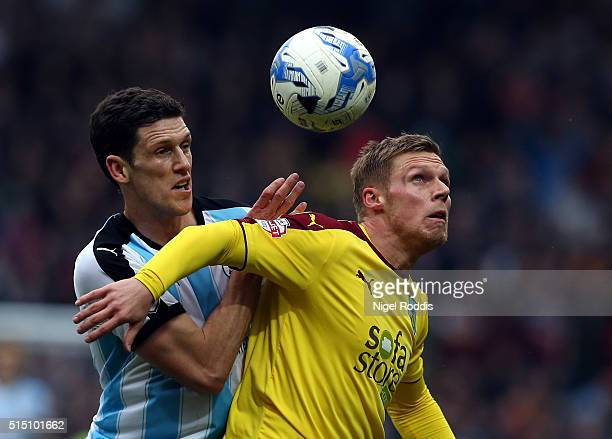 Mark Hudson of Huddersfield Town challenges Rouwen Hennings of Burnley during the Sky Bet Championship match between Huddersfield Town and Burnley at...