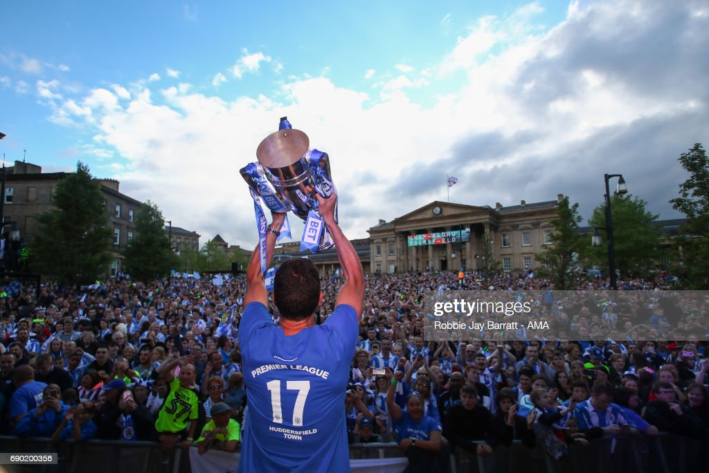 Mark Hudson of Huddersfield Town lifts the Sky Bet Championship Play offs trophy at Georges Square in Huddersfield on May 30, 2017 in Huddersfield, England.