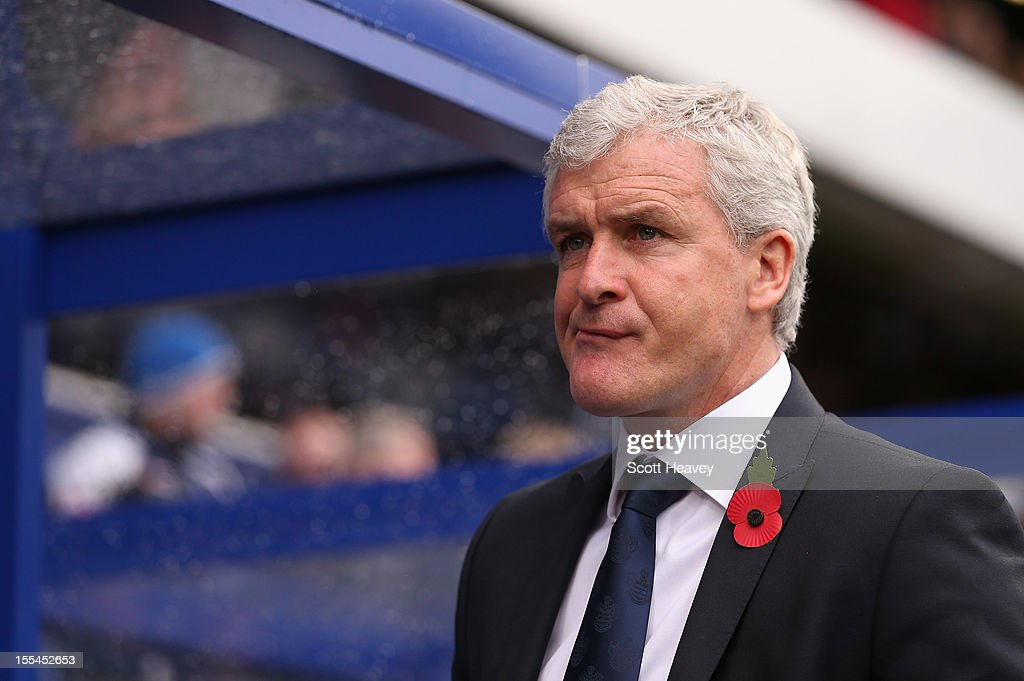 <a gi-track='captionPersonalityLinkClicked' href=/galleries/search?phrase=Mark+Hughes+-+Manager+di+calcio+gallese&family=editorial&specificpeople=206223 ng-click='$event.stopPropagation()'>Mark Hughes</a>, manager of Queens Park Rangers looks on prior to the Barclays Premier League match between Queens Park Rangers and Reading at Loftus Road on November 4, 2012 in London, England.