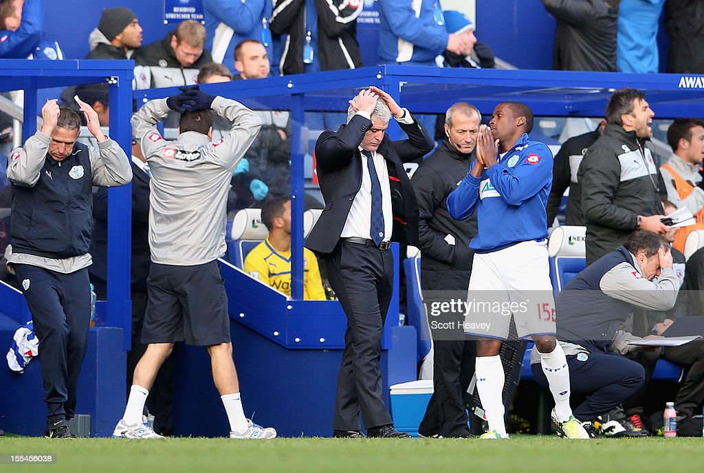 Mark Hughes, manager of Queens Park Rangers reacts during the Barclays Premier League match between Queens Park Rangers and Reading at Loftus Road on November 4, 2012 in London, England.