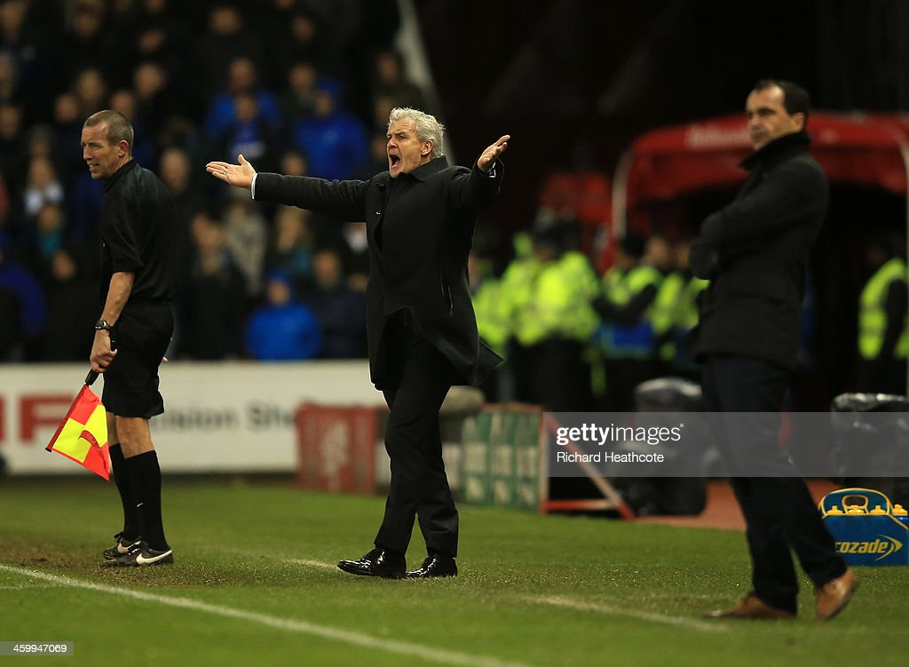 <a gi-track='captionPersonalityLinkClicked' href=/galleries/search?phrase=Mark+Hughes+-+Welsh+Soccer+Manager&family=editorial&specificpeople=206223 ng-click='$event.stopPropagation()'>Mark Hughes</a> manager of Stoke City appeals during the Barclays Premier League match between Stoke City and Everton at Britannia Stadium on January 1, 2014 in Stoke on Trent, England.