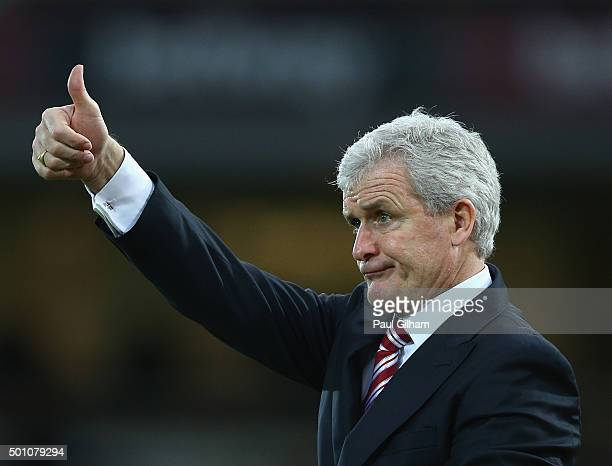 Mark Hughes manager of Stoke City gestures during the Barclays Premier League match between West Ham United and Stoke City at the Boleyn Ground on...