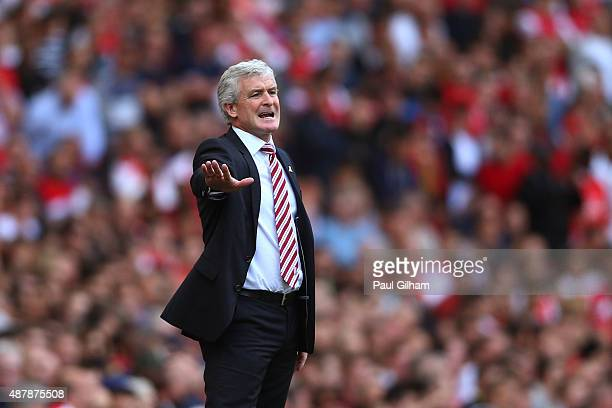 Mark Hughes Manager of Stoke City gives instructions during the Barclays Premier League match between Arsenal and Stoke City at the Emirates Stadium...