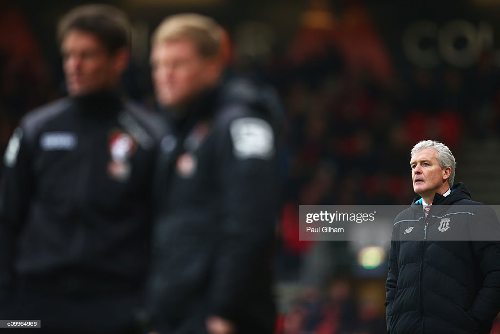 <a gi-track='captionPersonalityLinkClicked' href=/galleries/search?phrase=Mark+Hughes+-+Welsh+Soccer+Manager&family=editorial&specificpeople=206223 ng-click='$event.stopPropagation()'>Mark Hughes</a> (R) manager of Stoke City looks on during the Barclays Premier League match between A.F.C. Bournemouth and Stoke City at Vitality Stadium on February 13, 2016 in Bournemouth, England.