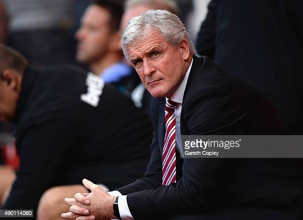 Mark Hughes manager of Stoke City looks on prior to the Barclays Premier League match between Stoke City and AFC Bournemouth at Britannia Stadium on...