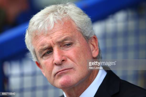Mark Hughes Manager of Stoke City looks on prior to the Premier League match between Everton and Stoke City at Goodison Park on August 12 2017 in...