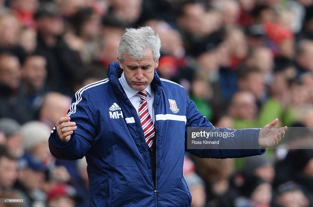 Mark Hughes manager of Stoke City reacts during the Barclays Premier League match between Stoke City and West Ham United at Britannia Stadium on March 15, 2014 in Stoke on Trent, England.