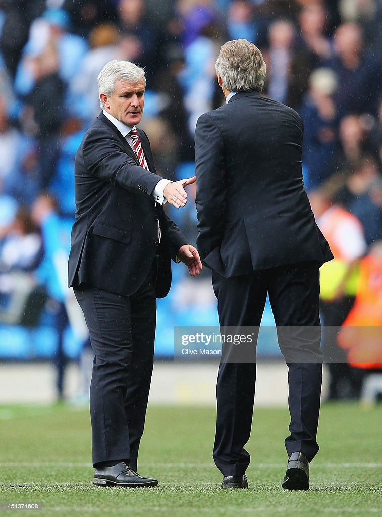 <a gi-track='captionPersonalityLinkClicked' href=/galleries/search?phrase=Mark+Hughes+-+Welsh+Soccer+Manager&family=editorial&specificpeople=206223 ng-click='$event.stopPropagation()'>Mark Hughes</a>, manager of Stoke City shakes hands with <a gi-track='captionPersonalityLinkClicked' href=/galleries/search?phrase=Manuel+Pellegrini&family=editorial&specificpeople=673553 ng-click='$event.stopPropagation()'>Manuel Pellegrini</a>, manager of Manchester City after the Barclays Premier League match between Manchester City and Stoke City at Etihad Stadium on August 30, 2014 in Manchester, England.