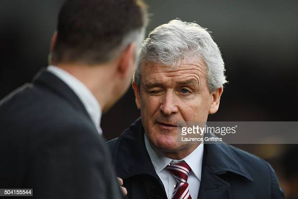 Mark Hughes manager of Stoke City winks Darren Ferguson manager of Doncaster Rovers prior to the Emirates FA Cup Third Round match between Doncaster...