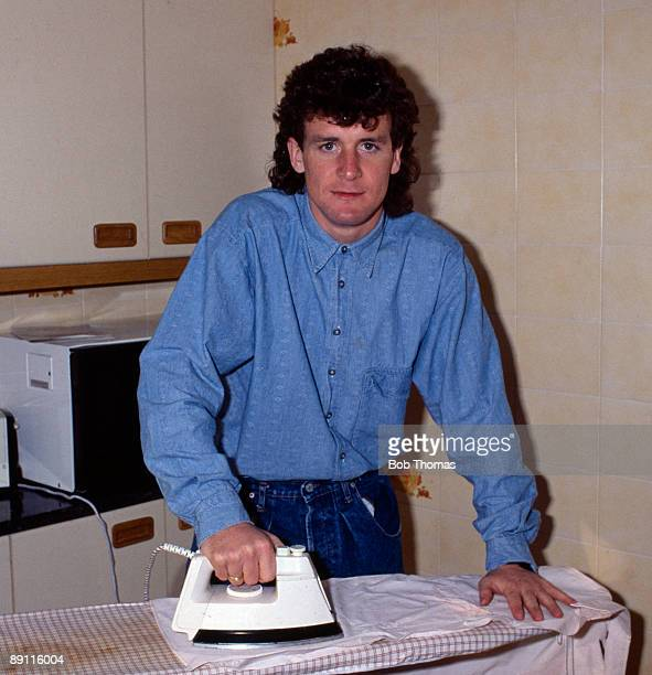 Mark Hughes of Barcelona ironing clothes at his home in Barcelona Spain during March 1987