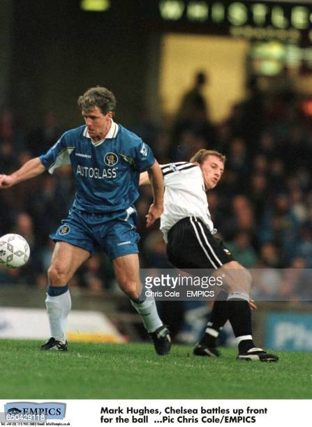 Mark Hughes of Chelsea takes the ball down as Derby County's Gary Rowett loses his balance