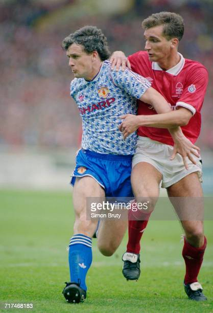 Mark Hughes of Manchester Utd holds onto the ball from the Nottingham Forest defender Darren Wassel during their Rumbelows Football League Cup Final...