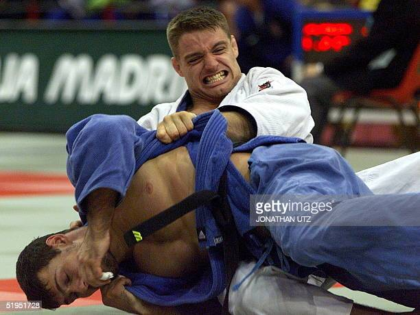 Mark Huizinga of the Netherlands struggles to take control of Dmitri Morozov of Russia during their under90kg second round match at the 26th Judo...