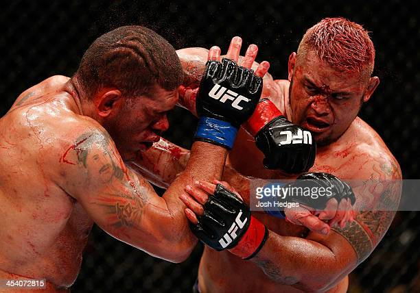 Mark Hunt elbows Antonio 'Bigfoot' Silva in their heavyweight fight during the UFC Fight Night event at the Brisbane Entertainment Centre on December...