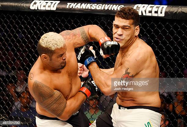 Mark Hunt lands a lefthanded punch against Antonio Silva in their heavyweight bout during the UFC 193 event at Etihad Stadium on November 15 2015 in...