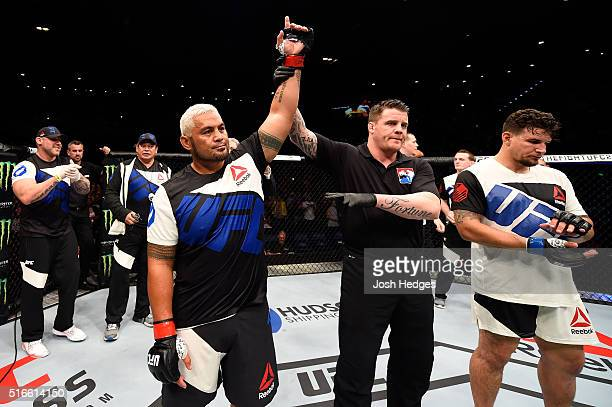 Mark Hunt of New Zealand celebrates after defeating Frank Mir of the United States after their heavyweight bout during the UFC Fight Night event at...