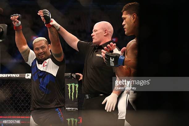 Mark Hunt of New Zealand celebrates victory over Antonio 'Bigfoot' Silva of Brazil in their heavyweight bout during the UFC 193 event at Etihad...