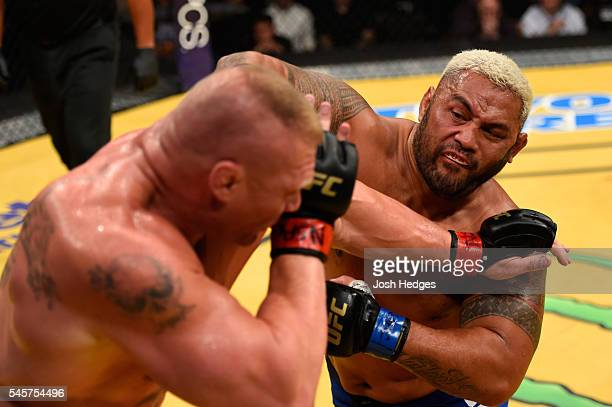 Mark Hunt of New Zealand punches Brock Lesnar in their heavyweight bout during the UFC 200 event on July 9 2016 at TMobile Arena in Las Vegas Nevada