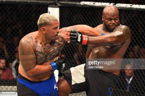Mark Hunt of New Zealand punches Derrick Lewis in their heavyweight fight during the UFC Fight Night event at the Spark Arena on June 11 2017 in...