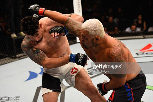 Mark Hunt of New Zealand punches Frank Mir of the United States in their heavyweight bout during the UFC Fight Night event at the Brisbane...
