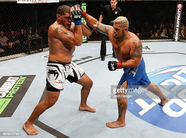 Mark Hunt punches Antonio 'Bigfoot' Silva in their heavyweight fight during the UFC Fight Night event at the Brisbane Entertainment Centre on...