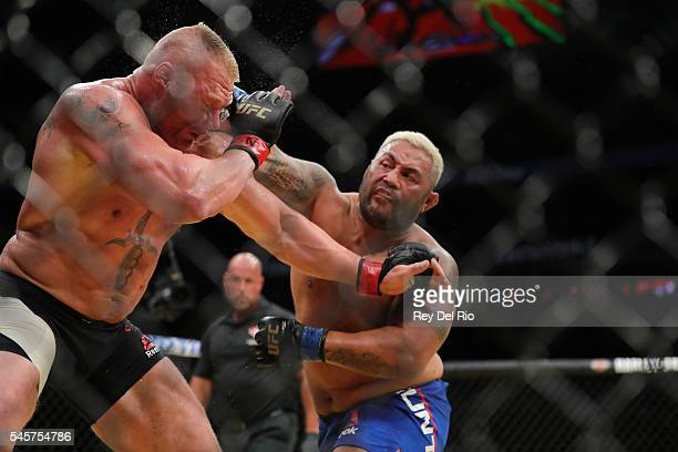 Mark Hunt punches Brock Lesnar during the UFC 200 event at TMobile Arena on July 9 2016 in Las Vegas Nevada