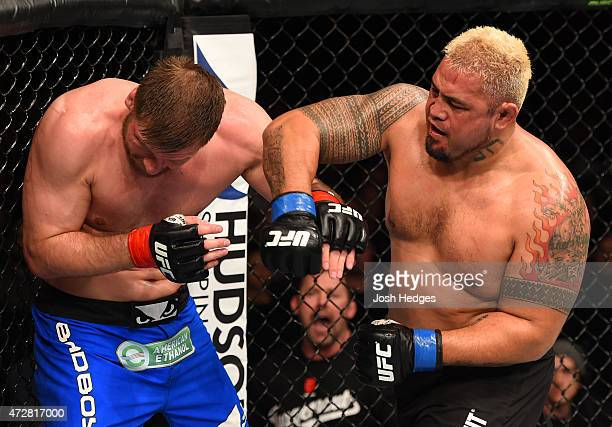 Mark Hunt punches Stipe Miocic in their heavyweight bout during the UFC Fight Night event at the Adelaide Entertainment Centre on May 10 2015 in...