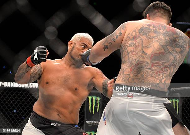 Mark Hunt throws a punch against Frank Mir during their UFC Heavyweight Bout at UFC Brisbane on March 20 2016 in Brisbane Australia