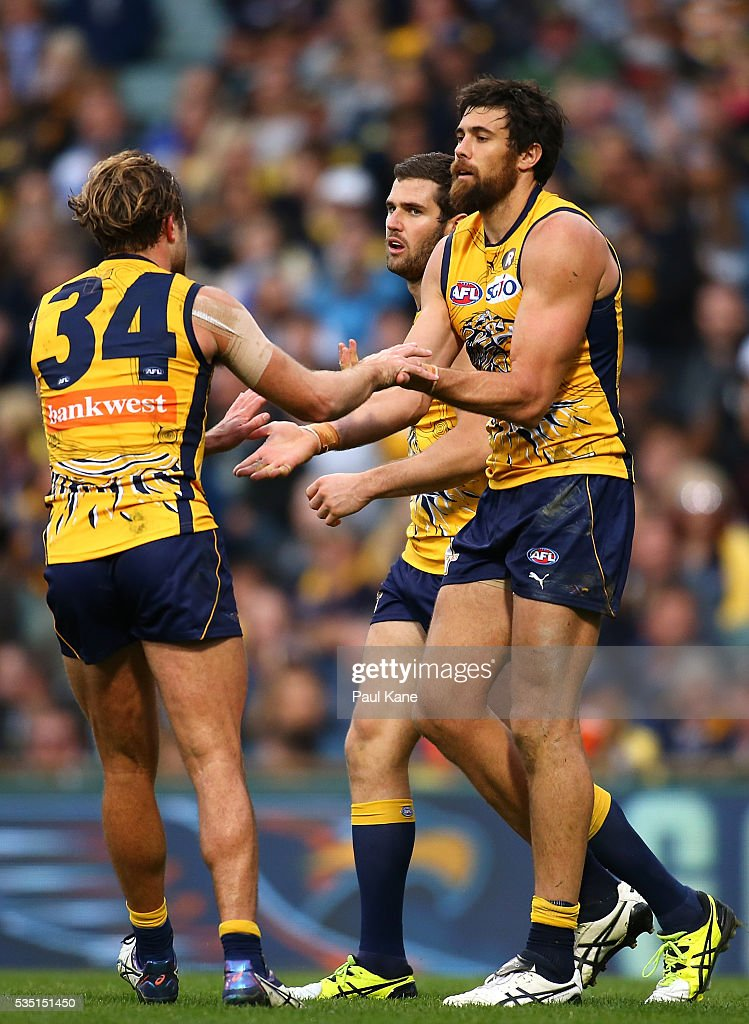 Mark Hutchings and Josh Kennedy of the Eagles celebrate a goal during the round 10 AFL match between the West Coast Eagles and the Gold Coast Suns at Domain Stadium on May 29, 2016 in Perth, Australia.