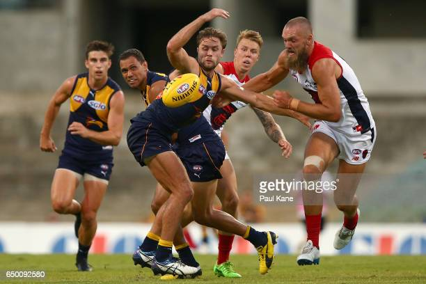 Mark Hutchings of the Eagles and Max Gawn of the Demons contest for the ball during the JLT Community Series AFL match between the West Coast Eagles...