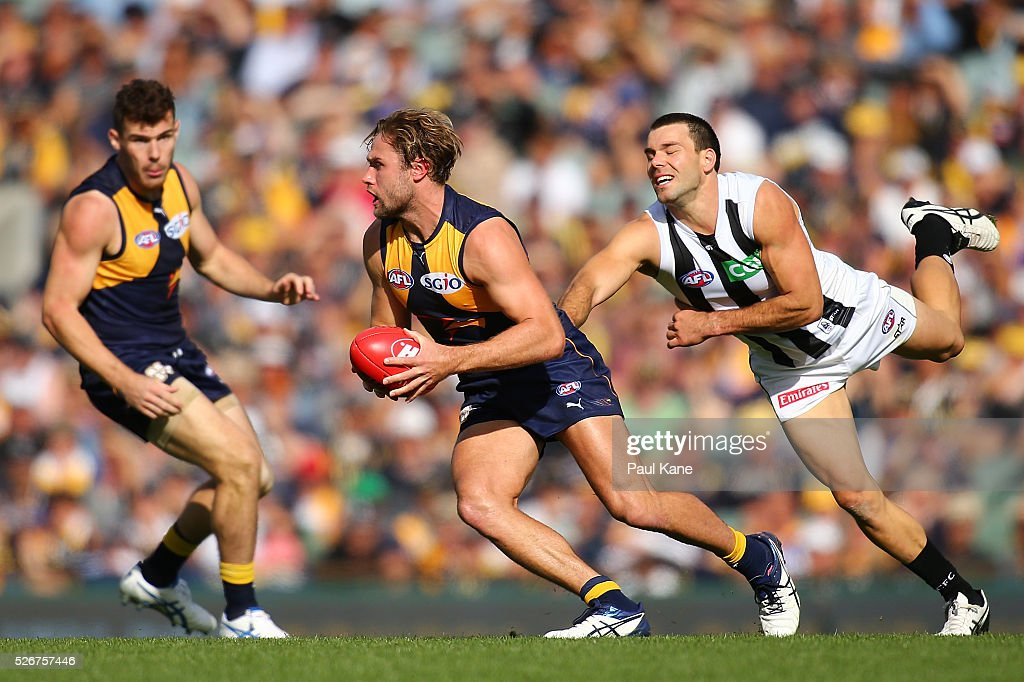 Mark Hutchings of the Eagles breaks a tackle by Levi Greenwood of the Magpies during the round six AFL match between the West Coast Eagles and the Collingwood Magpies at Domain Stadium on May 1, 2016 in Perth, Australia.