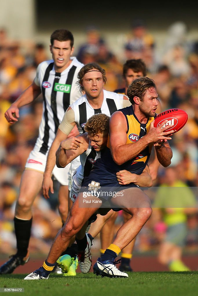 Mark Hutchings of the Eagles gets tackled by Adam Treloar of the Magpies during the round six AFL match between the West Coast Eagles and the Collingwood Magpies at Domain Stadium on May 1, 2016 in Perth, Australia.