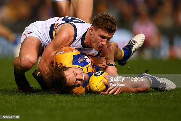 Mark Hutchings of the Eagles gets tackled by Rory Laird of the Crows during the round 12 AFL match between the West Coast Eagles and the Adelaide...