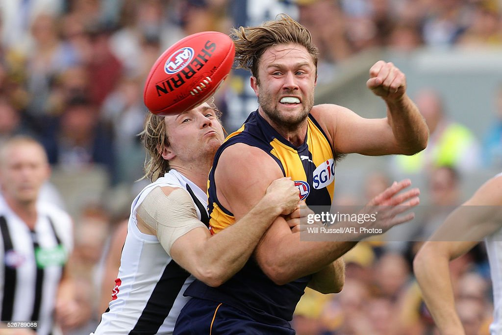 Mark Hutchings of the Eagles handballs under pressure from Ben Sinclair of the Magpies during the round six AFL match between the West Coast Eagles and the Collingwood Magpies at Domain Stadium on May 1, 2016 in Perth, Australia.