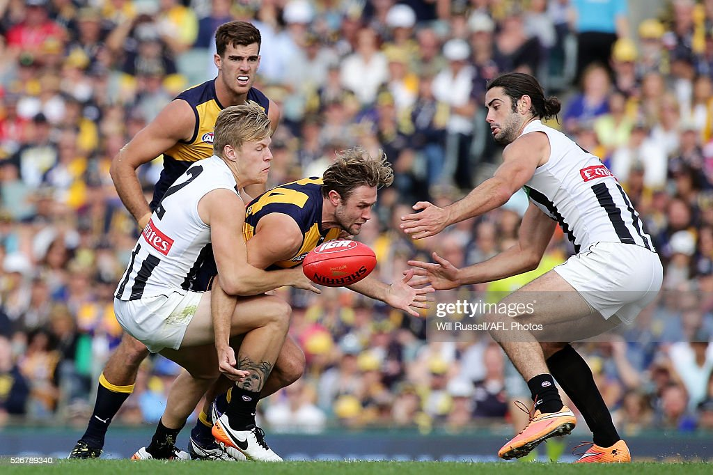 Mark Hutchings of the Eagles is tackled by Jordan De Goey of the Magpies during the round six AFL match between the West Coast Eagles and the Collingwood Magpies at Domain Stadium on May 1, 2016 in Perth, Australia.