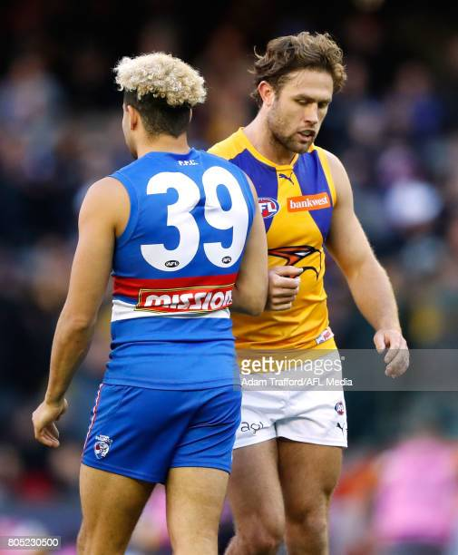 Mark Hutchings of the Eagles remonstrates with Jason Johannisen of the Bulldogs during the 2017 AFL round 15 match between the Western Bulldogs and...