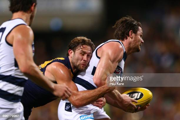 Mark Hutchings of the Eagles tackles Patrick Dangerfield of the Cats during the round 13 AFL match between the West Coast Eagles and the Geelong Cats...