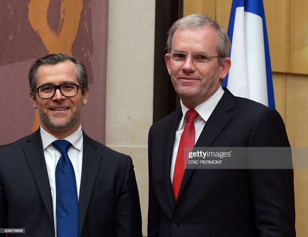 Mark Hutchinson (R), President and Chief Executive Officer of General Electric (GE) Europe and General Electric France, Vincent Champain, GE France Director of Operations, pose prior to the start Hutchinson's hearing on the restructuring of the GE group by the Economic Affairs Commission of the French National Assembly in Paris on February 10, 2016. / AFP / ERIC PIERMONT