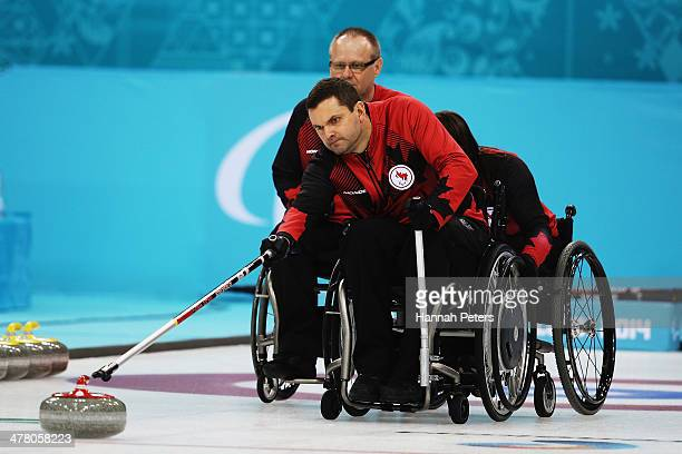 Mark Ideson of Canada competes in the wheelchair curling round robin session 9 match between Korea and Canada on day five of Sochi 2014 Paralympic...