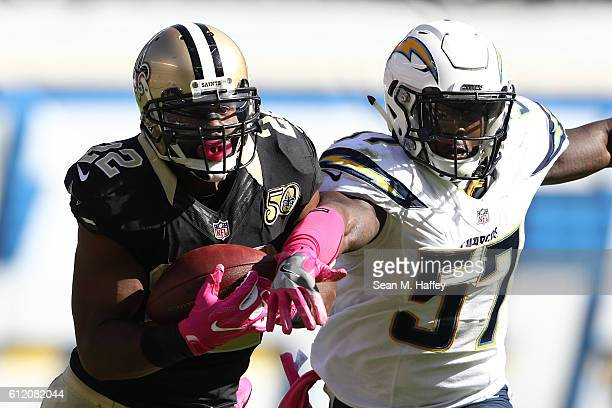 Mark Ingram of the New Orleans Saints catches as pass as Jatavis Brown of the San Diego Chargers defends during the first half of a game at Qualcomm...