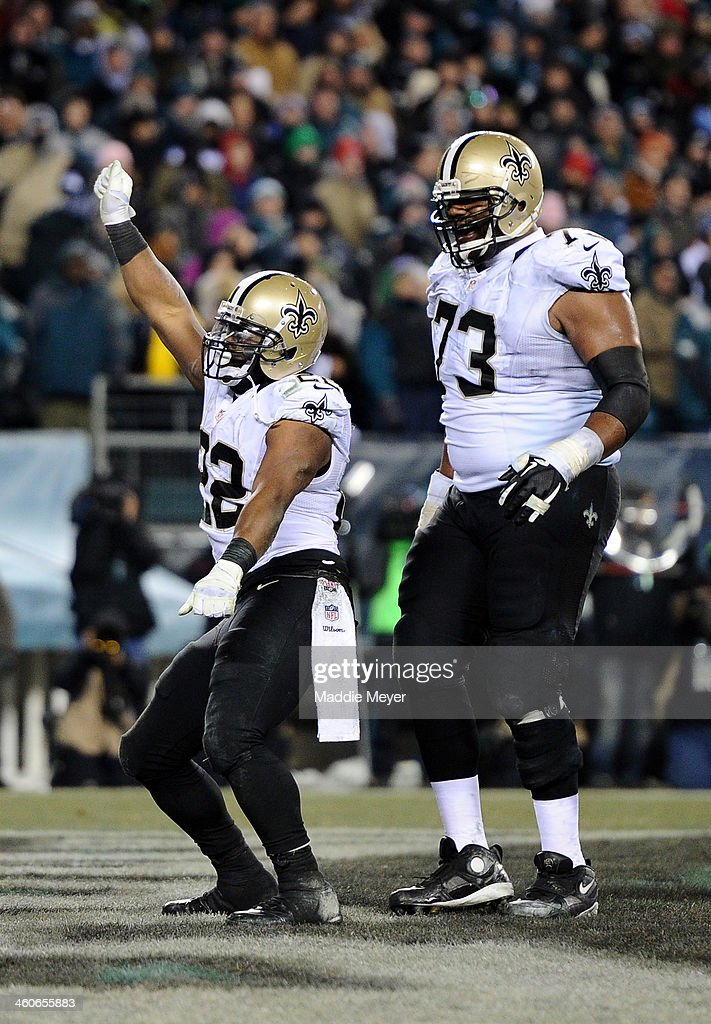 Mark Ingram #22 of the New Orleans Saints celebrates after running for a 4 yard touchdown in the third quarter against the Philadelphia Eagles during their NFC Wild Card Playoff game at Lincoln Financial Field on January 4, 2014 in Philadelphia, Pennsylvania.