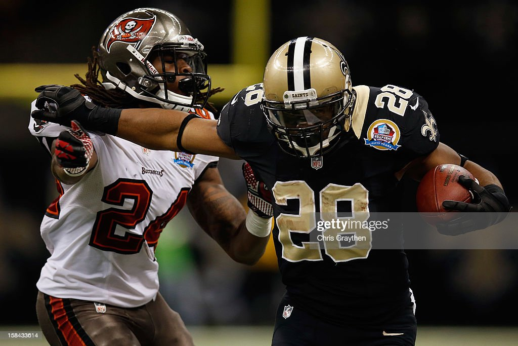 <a gi-track='captionPersonalityLinkClicked' href=/galleries/search?phrase=Mark+Ingram&family=editorial&specificpeople=578256 ng-click='$event.stopPropagation()'>Mark Ingram</a> #28 of the New Orleans Saints is pushed out of bounds by <a gi-track='captionPersonalityLinkClicked' href=/galleries/search?phrase=Mark+Barron&family=editorial&specificpeople=2593511 ng-click='$event.stopPropagation()'>Mark Barron</a> #24 of the Tampa Bay Buccaneers at the Mercedes-Benz Superdome on December 16, 2012 in New Orleans, Louisiana. The Saints defeated the Buccs 41-0.