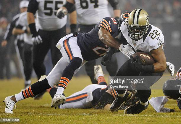 Mark Ingram of the New Orleans Saints is tackled by Ryan Mundy of the Chicago Bears during the first quarter at Soldier Field on December 15 2014 in...