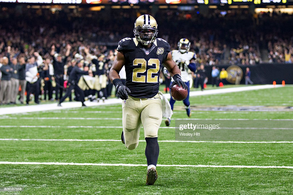 Mark Ingram #22 of the New Orleans Saints runs the ball in for a touchdown during a game against the Los Angeles Rams at Mercedes-Benz Superdome on November 27, 2016 in New Orleans, Louisiana. The Saints defeated the Rams 49-21.