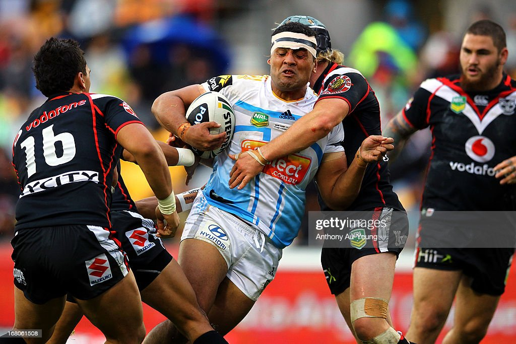 Mark Ioane of the Titans charges against Todd Lowrie of the Warriors during the round eight NRL match between the New Zealand Warriors and the Gold Coast Titans at Mt Smart Stadium on May 5, 2013 in Auckland, New Zealand.
