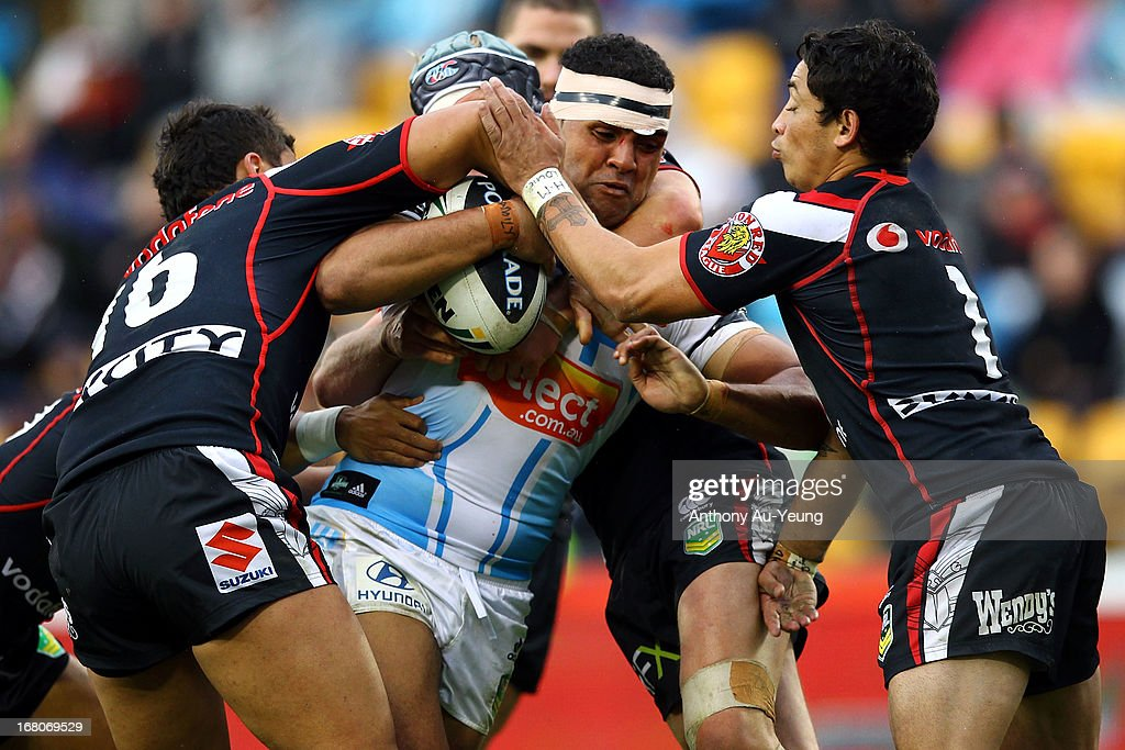 Mark Ioane of the Titans charges into the Warriors defence during the round eight NRL match between the New Zealand Warriors and the Gold Coast Titans at Mt Smart Stadium on May 5, 2013 in Auckland, New Zealand.